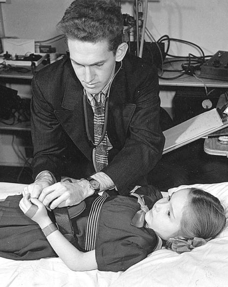 An unidentified Fels Longitudinal Study doctor is shown here circa the 1950s examining a young participant. The longest and largest longitudinal health study in the world, the Fels study, for many years based in Yellow Springs, still has more than 1,000 participants in the area, who had yearly appointments beginning in childhood to gather information on body composition. Last month Wright State closed down data collection for the Fels study, which would have turned 90 next year. (Photo courtesy of Antiochiana, Antioch College)