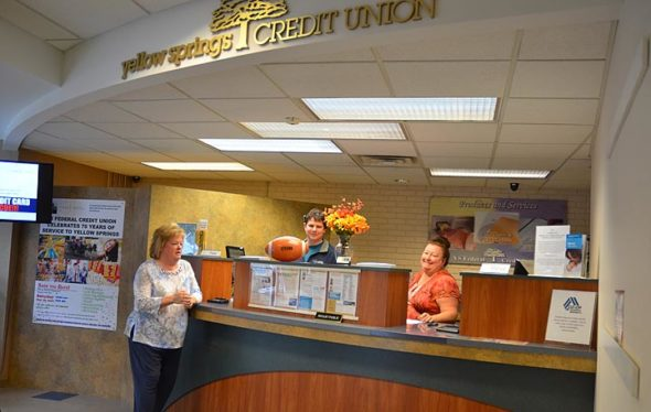 The Yellow Springs Federal Credit Union is marking its 70th anniversary with a public celebration on Saturday, Sept. 29, from 10 a.m. to 2 p.m., at its downtown offices. Pictured are YSCU President and CEO Sandy Hollenberg, left, and employees Peter Mayne and Angel Johnston. (Photo by Carol Simmons)