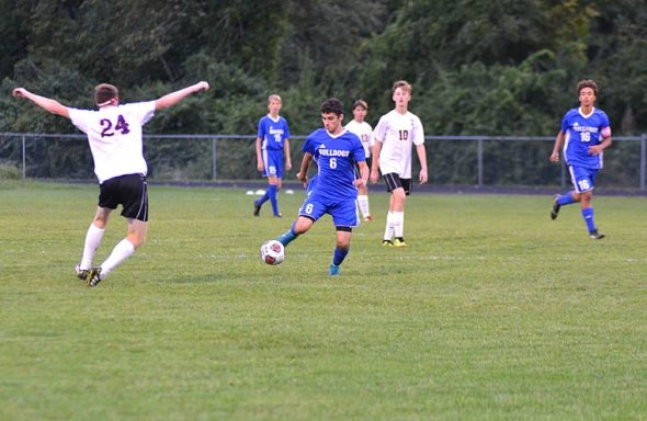 YSHS forward Kaden Bryan stole the ball from an Emmanuel Christian player on the way to a breakaway goal against the visitors during the YSHS's 15–1 win at home on Sept. 27. Bryan leads the team this year in goals and assists, with 14 apiece. (Photo by Megan Bachman)