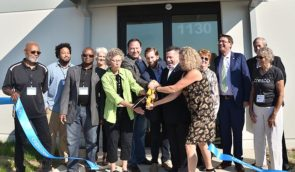 At the ribbon cutting ceremony, Monday, Oct. 8, signaling the official opening Cresco Labs, with members of Yellow Springs Village Council, school board, and Chamber of Commerce. Present also were State Representative Rick Perales and Cresco CEO Charlie Bachtell. (Photo by Megan Bachman)