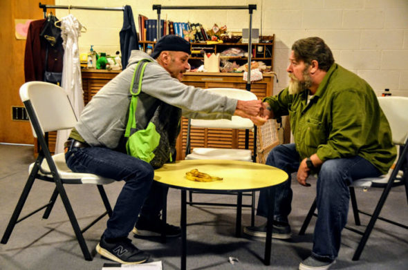 "Robb Willoughby, left, and Troy Lindsey rehearse a tense scene from ""Bro"" over a pair of aging bananas in the Sunday school room at First Presbyterian Church. ""Bro"" is one of the short plays that will be performed as part of the YS Theater Company's production of ""W3 — Three Humorous Tales of Horror,"" opening this weekend, Friday–Saturday, Oct. 26–27, at 8 p.m. and continuing the following weekend. (Photo by Lauren ""Chuck"" Shows)"