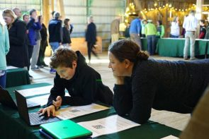 McKinney 7th-grader Otto Cipollini showed his mother, Kendra, his water quality findings from tests on the Jacoby Creek and Little Miami River during the Into The Wild exhibition night held at the Agraria Barn last month. (Submitted photo by Amy Harper)