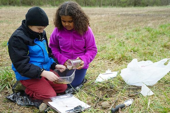 Mills Lawn third-graders Emery Fodal and Wyatt Fagan counted soil invertebrates using Berlese Funnels at Agraria last spring. They also kept data on soil temperature levels over a four-week period at the farm. (Submitted photo by Peg Morgan)