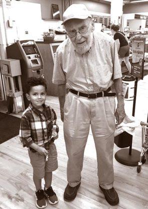 Jim Agna at Tom's with his grandson Intharat (Eton) Jennikron.