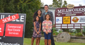 New villagers Jessica Yamamoto and Antonio Molina, pictured with their nine-year-old twin daughters, Sophia and Jessie, are the new owners of Millworks Business Center. The couple buys and rehabs properties that they resell or maintain as rentals. (Photo by Carol Simmons)