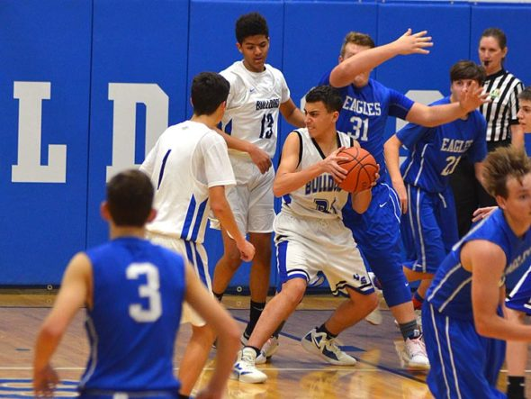Sophomore Sam Lewis retrieves the ball during the Friday, Dec. 7, JV game aginst Middeltown Christian. Despite rallying efforts, Bulldogs lost their game, 41–22. (Photo by Matt Minde)