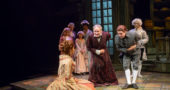 Old Ebenezer Scrooge (Bruce Cromer) and his younger self (Charlie Cromer) bow to Belle (Sara Masterson).