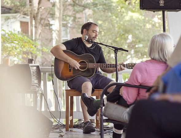 Guitarist Mark Babb performing recently at the Mills Park Hotel during Porch Fest.