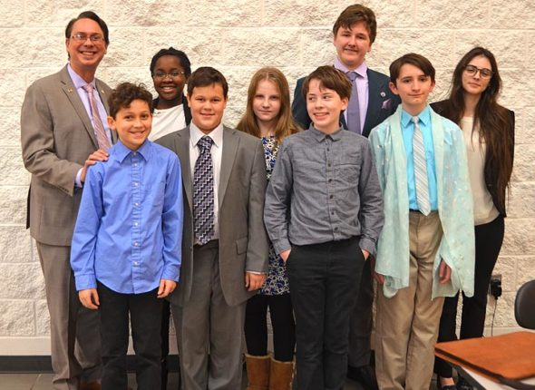 Members of the Yellow Springs Speech and Debate team participated in the annual Beavercreek Phoenix Invitational Tournament on Saturday, Jan. 5, at Beavercreek High School. From left are: coach Brian Housh, Miles Gilchrist, Gini Meekin, Solan Palmer, Payton Horton, Kian Barker, Galen Sieck, Colon Anderson and Lily Bryan. Not pictured is co-coach Jackie Anderson. The team will host its first local tournament, titled The Fearless Forensics Festival, on Saturday, Jan. 26. (photo by Carol Simmons)