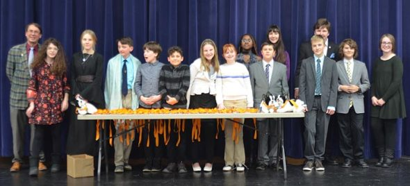 In its second year, the Yellow Springs Debate Team played host to 13 other schools in the first Fearless Forensic Festival, Saturday, Jan. 26. Lined up to present the awards are, from left, coach Brian Housh, and students Eva Vescio, Mackenzie Horton, Conor Anderson, Kian Barker, Miles Gilchrist, Payton Horton, Maggie Wright, Gini Meekin, Solan Palmer, Ashlyn Bailey, Luka Sage-Frabotta, Galen Sieck, Oliver Bahn and Sydney Roberts.