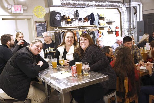 Christie Finney, Mary Taylor and Emily Rigsbee, in the foreground from left, are friends and have attended Trivia Nights at the Brewery fairly regularly for three years. They say they've never won, but have come close a few times. They welcomed this reporter to join their team, and we came in a respectable fourth place. (Photo by Gary McBride)