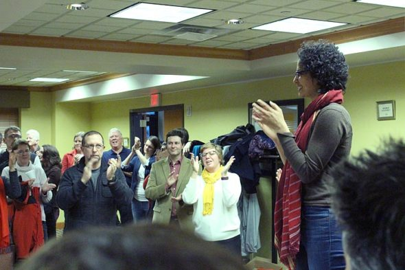 Wright State faculty and friends celebrated the end of their 20-day strike on Monday. Associate professor of economics and the union's grievance officer Sirisha Naidu (at right) congratulated the crowd at strike headquarters for standing together. (Photo by Gary McBride)