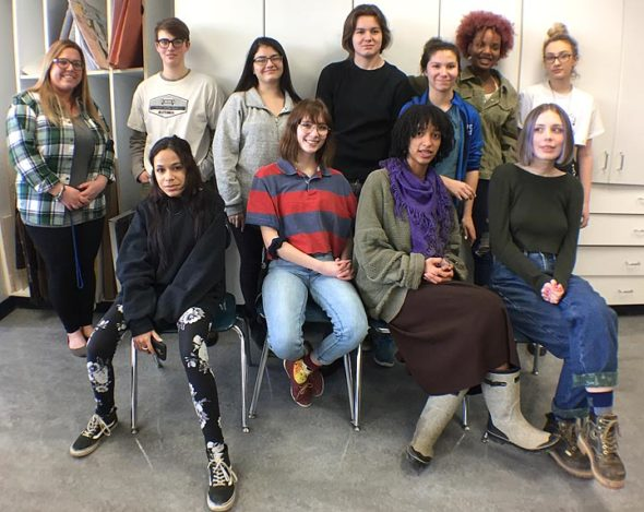 Shown above are YSHS art teacher Emily Cormier, left, and advanced art students who participated in a project to decorate shoes promoting social causes important to student athletes. Front row, from left: Indra Dickens, Riley Duncan, Sumayah Chappelle, Alexa Spitz. Back row: Cormier, Jacob Bledsoe, Lucy Anderson, Jasiah Zinger-Mitchell, Jude Meekin, Shakerriah Brown and Meryam Raissouni. (Photo by Carla Steiger)
