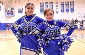 Cheerleaders Stella Lieff and Rosemary Burmester struck a pose during a recent boys JV basketball game. (Submitted photo by Luciana Lieff)
