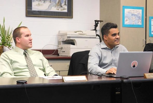 From left, YSHS/McKinney Interim Principal Jack Hatert and Superintendent Mario Basora at last week's school board meeting. Basora is heading to a job in Huber Heights, while Hatert has applied for the principal position at YSHS/McKinney. (Photo by Gary McBride)