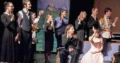 "Auf wiedersehen, Gesundheit! The Sound of Music has been rescheduled once more for April 11–14. Pictured above are members of the cast waving ""auf wiedersehen, goodbye"" at a rehearsal March 6, shortly before flu and other upper respiratory illnesses laid low many of the performers and their classmates. (Photo by Luciana Lieff)"
