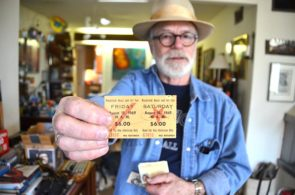 Duke Dewey and the drumset he used at Woodstock Music and Art Fair, where he performed with Country Joe and the Fish. Below: Dewey holds a ticket stub from the historic music festival. (Photo by Megan Bachman)