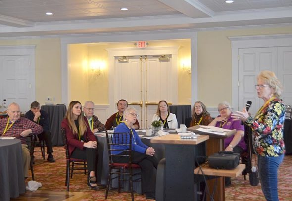 At last Friday's wrap-up breakfast for Dementia Friendly Yellow Springs, Gilah Pomeranz spoke on the project's positive effects on downtown businesses. About 50 people attended the event, which brought the 18-month project, sponsored by the Yellow Springs Senior Center, to an end. (Photo by Diane Chiddister)