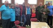 Former members of the Mystic Knights of Nowhere and H.U.M.A.N met earlier this year at the Yellow Springs Library to reminisce. From left: Neal Crandall, Pam Davis, Joan Chappelle, Aminullah Ahmad, Donna Silvert, Priscilla Moore, Victor Garcia, Tanya Fetcho and Mike Miller. (Submitted photo )