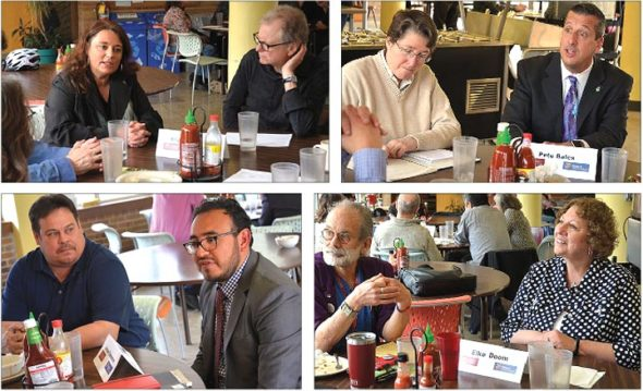 The four finalists for Yellow Springs Village manager visited town last week for a three-day whirlwind of tours, meetings, presentations and interviews. On Wednesday, April 10, the candidates met with community leaders for roundtable discussions over lunch in Birch Hall at Antioch College. Clockwise from top left, Antioch College President Tom Manley listened to candidate Allyson Murray; Lisa Abel jotted down notes while candidate Pete Bales spoke; villager Pan Reich and candidate Elke Doom looked on; Scott Osterholm watched as candidate Josue Salmon answered a question. Council made an offer to an unidentified candidate this week. (Photos by Megan Bachman)