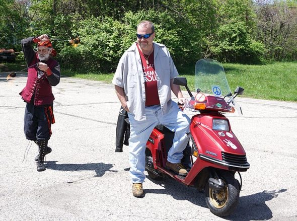 "On Sunday, May 5, at the edge of Antioch College, the Yellow Springs First Annual Pagan Blessing Of The Bikes took place. Above, Jeff ""Pan"" Reich (at left in the photo) fulfilled his ""high priest"" role very convincingly. (Photo by Carlos Landaburu)"