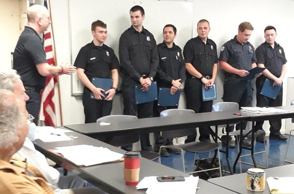 Six Miami Township Fire-Rescue squad members were honored Monday, May 6, during the Miami Township Trustees' regular meeting. Pictured, from left, are Chief Altman, Emergency Medical Technician (EMT) student Casey Brewer, Firefighter/EMT Ryan Evans, Firefighter/Paramedic Joe Panuto, Firefighter Ryan Schroeder, Firefighter/EMT Nick Miller-Jacobson and firefighter/Emergency Medical Responder TJ Fries. (Photo by Carol Simmons)