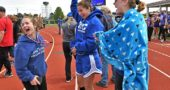 Girls track athletes, from left, Sophia Lawson, Jude Meekin and Natalie Galarza celebrated the girls team's first-place win at the Metro Buckeye Conference championship Saturday, May 11. (Photo by Kathleen Galarza)