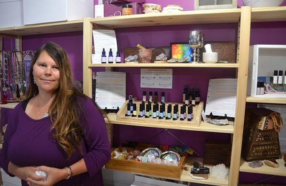 Stephanie Palmer, the only registered aromatherapist in Ohio, will open the doors of Awaken Essential Oils to the public beginning June 8. In addition to her wide array of hand-blended and fragrant oils, Awaken Essential Oils offers a diverse collection of tea blends, gemstones, crystals, incense, jewlery and an assortment of spiritual tools. Here, she holds a pearly hunk of apophyllite. (Photo by Reilly Dixon)