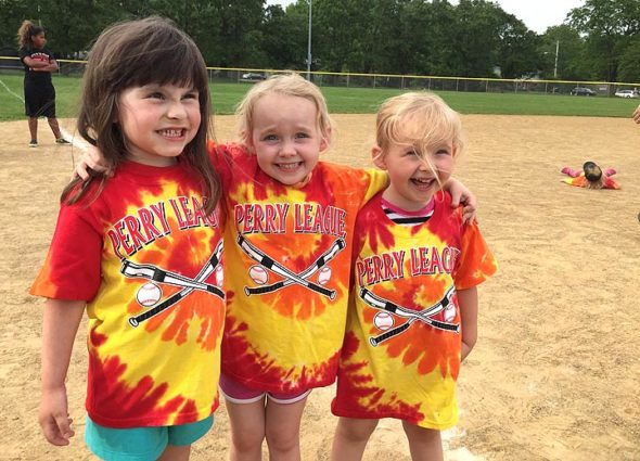 Fiona Garcia, Violet Ficke and Amber Ficke cheesed for the camera at last Friday's Perry League game — Coach Jimmy was able to fit them into the batting line-up at the proverbial bottom of the ninth. (Submitted Photo by Heather Hunter)