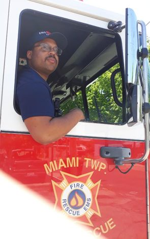 MTFR Firefighter/EMT Josh Sweet sits in the passenger side of one of the department's fire engines after responding to a call Tuesday morning, June 11. (Photo by Carol Simmons)