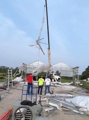 A crane lifts sections of the former greenhouse at Oasis Aqua Farms along Beaver Valley Road. (Submitted Photo)