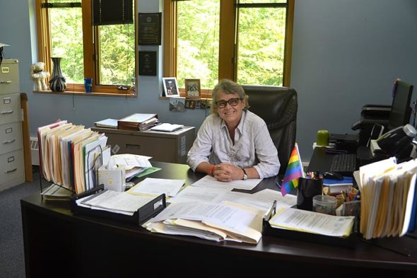 Patti Bates departs the Village's top job at the end of June. The outgoing Village manager recently sat at the desk where she worked for the last five years. (Photo by Megan Bachman)
