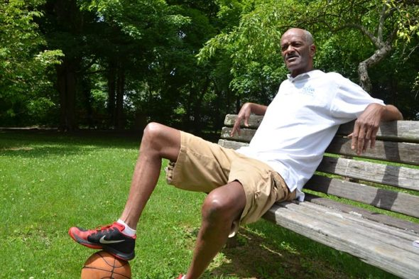 Sterling Wright, a former pro basketball player and International Olympic Committee master instructor, relaxed in Beatty Hughes Park on a recent afternoon. As a youth growing up in Yellow Springs, he spent time in the teen center formerly located at the park. (Photo by Audrey Hackett)