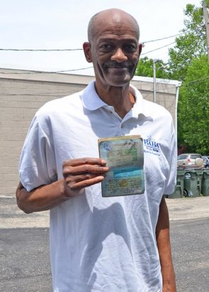 Former pro basketball player and coach Sterling Wright shows off his well-traveled passport. (Photo by Audrey Hackett)