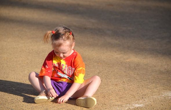 Laurelai Myers contemplated the dirt during Perry League T-ball on Friday, June 14.  (Photo by Megan Bachman)