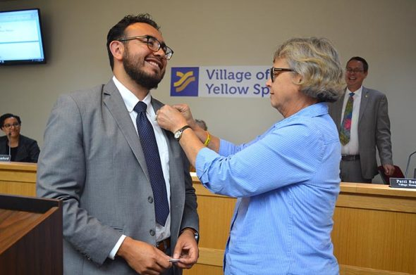 New Village Manager Josue Salmeron was sworn in at Council's meeting on Monday, June 17. In an impromptu ceremony, outgoing manager Patti Bates went on to fasten Salmeron's lapel with an official Village of Yellow Springs pin. (Photo by Megan Bachman)