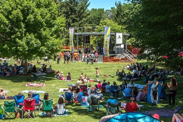 Crowds gathered on the grounds of the Bryan Center early in the day at last year's SpringsFest. The music festival will return this Saturday, July 6, 11 a.m.–11 p.m., with a new lineup of acts, as well as food, beer and art vendors. (YS News archive photo by Megan Bachman)