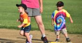 Ella Bristline, 3, took off for the base, leaving Topher Besson, 3, on the bag and in the dust on Friday's Perry League T-ball game. (Photo by Luciana Lieff)