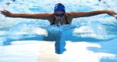 Sea Dog swimmer Natalie Galarza butterflied during the 200-meter individual medley race at the league championships last week. Galarza placed fourth in the event. (Photo by Kathleen Galarza)