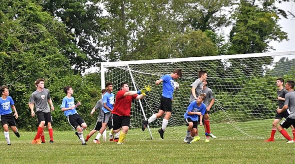 Above, from left, Yellow Springs players Eli Eyrich, Dylan Mapes, Yanne Gilley, Finn Bledsoe and Cedar Palmer clustered around the goal as Bledsoe headed the ball into the goal at the 6th Annual Yellow Springs High School Boys Pre-Season Soccer Tournament. (Photo by Kathleen Galarza)
