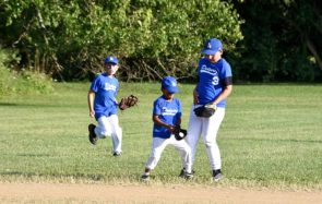 The Peach's Dodgers lost to the Nipper's Corner Yankees in very close semi-final game 9–8 on Wednesday, July 24. Above, Jacob Obringer, Ezra Lydy and Ben Morris of the Dodgers show some fast fielding action. (Photo by Luciana Lieff)