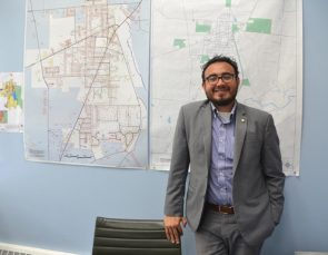 "New Village Manager Josue Salmeron, pictured here in his office, has had a busy first month on the job. ""You realize you have so may things going on, so many things to address,"" he said. ""It takes your breath away."" (Photo by Megan Bachman)"