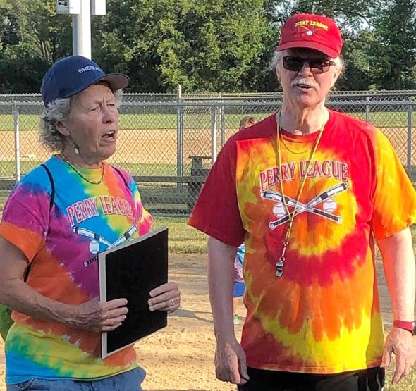 Mayor Pam Conine proclaimed Friday, Aug. 2 to be Coach Jimmy Appreciation Night during the weekly Perry League T-ball game, in honor of Jimmy Chesire's 34 years of coaching T-ball and many years of writing up the games for the Yellow Springs News for both parents and kids to enjoy. (Submitted photo by Robin Suits)