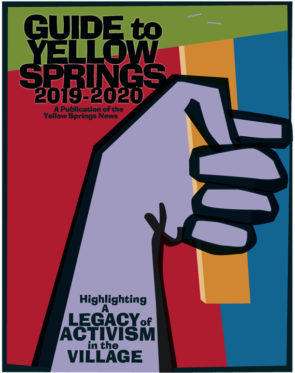 "This year's Guide to Yellow Springs cover hearkens back graphically to the 1960s era of American protest art. It recalls the iconic ""fist in the air,"" here holding a protest sign. (Design by Matt Minde)"
