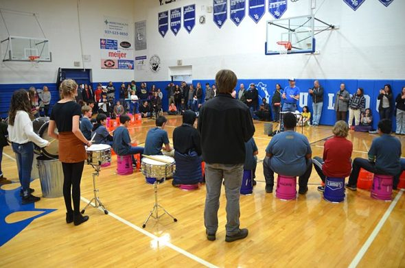 "New at this year's PBL exhibit is music teacher Brian Mayer's ""Non-Traditional Instrumental Music Class"" for 7th- and 8th-graders. The large drumming circle used buckets as well as traditional percussion instruments. (Photo by Matt Minde)"