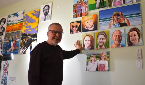 Local artist Tim Potter, shown here in his home studio with his portraits of family members in the background, will show about 50 portraits of villagers at The Winds Café this month and next. An opening reception for the exhibit takes place Sunday, Jan. 27, from 4 to 6 p.m. (Photo by Diane Chiddister)