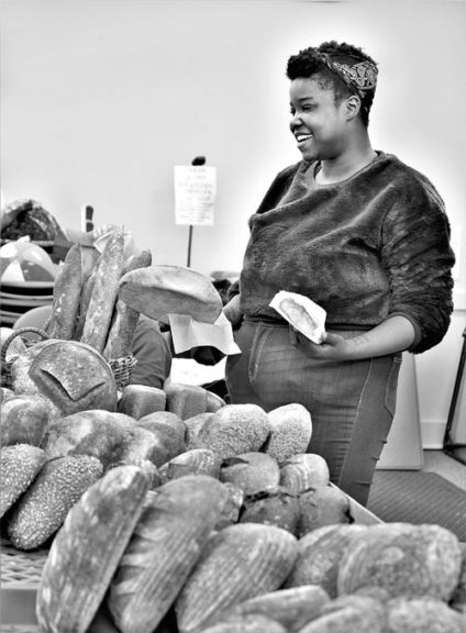 Robyn Weigand, of Blue Oven Bakery, of Cincinnati, sold a variety of leavened pleasures at last Saturday's winter farmers market in the Senior Center Great Room.  (Photo by Kathleen Galarza)