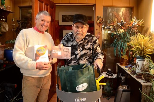 Yellow Springs Arts Council President Jerome Borchers delivered the pantry staples of flour and sugar — per a stipulation of Wheeling Gaunt's will — to local widower, poet Arnold Adoff, in late December. (Photo by Megan Bachman)