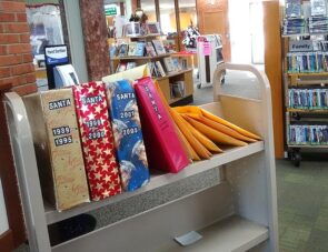 """Binders filled with letters to Santa, collected by the YS Library over the last three decades. (Photo by Lauren """"Chuck"""" Shows)"""