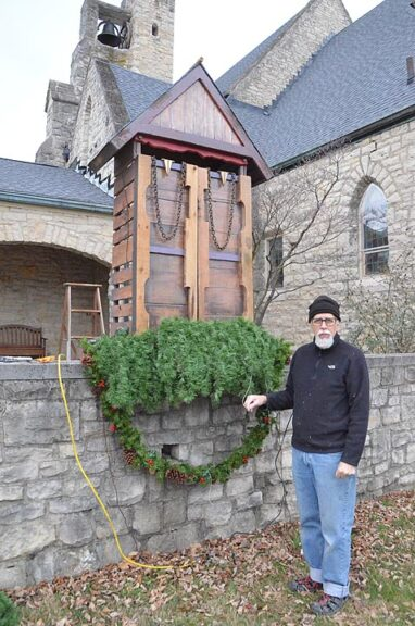 Visual artist Brian Millar stands by the creche he built last year for the First Presbyterian Church. The structure had to be weatherproofed and moved outside because Christmas eve services were held online. (Photo by Matt Minde)